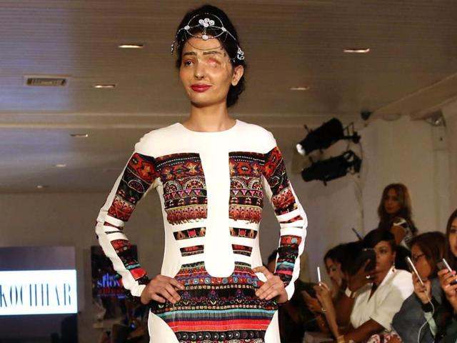 Acid attack survivor Reshma Bano from India walks the ramp during the FTL Moda presentation at New York Fashion Week.