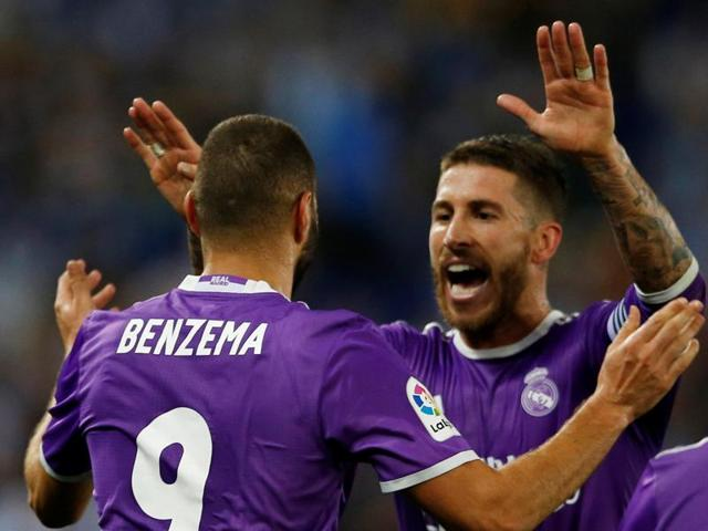 Real Madrid's Karim Benzema and Sergio Ramos celebrate a goal.