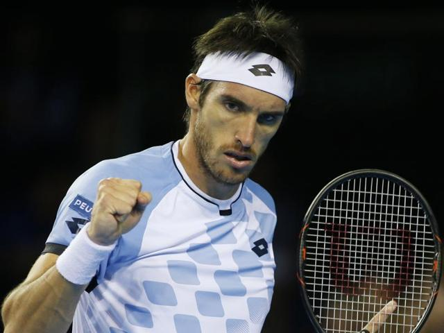 Argentina's Leonardo Mayer observes the ball during his game against Great Britain's Dan Evans.