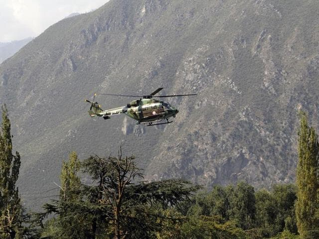 An army helicopter flies above the army base in Uri that was attacked by militants.
