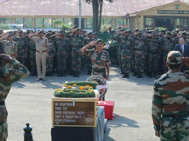 Army personnel pay their last respects to soldiers killed in the terrorist attack in Uri.