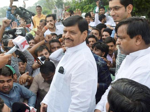 SP leader Shivpal Yadav addresses supporters outside his residence in Lucknow.