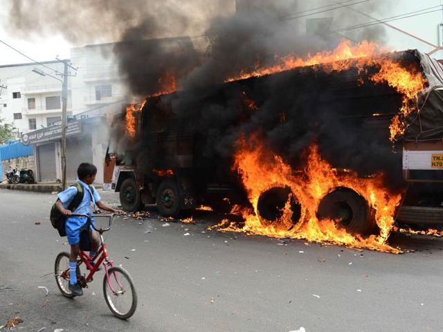 A truck which had Tamil Nadu registration plate is in flames in Bangalore after being set ablaze by protesters opposed to sharing Cauvery water.