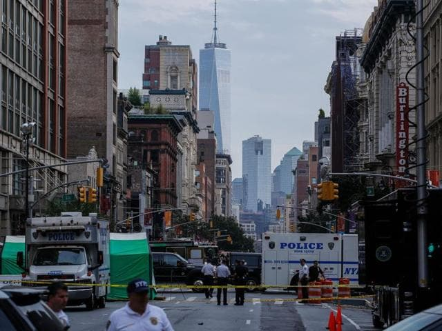 Law enforcement officers are seen at the scene of an explosion on West 23rd Street in New York.