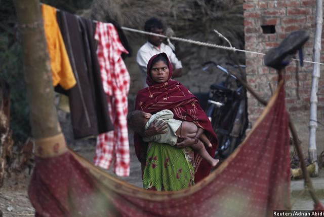 A woman holds her child as she stands outside her house at the Dalit village of Bhaddi Kheda in Lucknow district, Uttar Pradesh. More than one-third of the funds allocated by central ministries to the two funds meant for Dalits and the adivasis–the Scheduled Caste Sub Plan (SCSP) and the Tribal Sub Plan (TSP)–remained unspent in 2014-15. Corruption drains away the little that does trickle down to the Dalits and adivasis, an IndiaSpend investigation found.