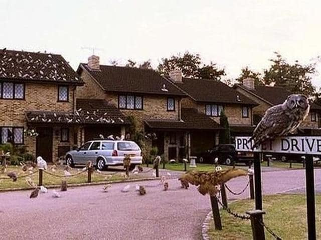 Professor McGonagall waits on the Privet Drive sign in the first Harry Potter film.