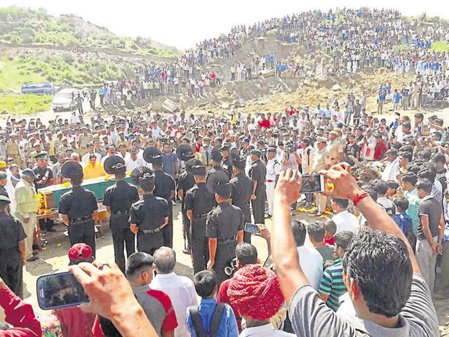 Thousands pay tributes to soldier  Nimbh Singh Rawat at  Rajwa village in Rajsamand district on Tuesday.