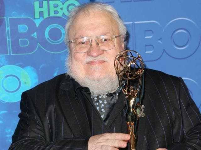 Actor Emilia Clarke and writer George RR Martin accept Outstanding Drama Series for Game of Thrones onstage during the 68th Annual Primetime Emmy Awards.