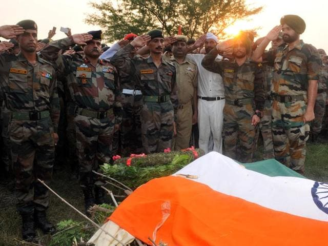 Soldiers during the last rite of Ravi Paul with full military honours at his village - Sarwah in Samba district  on Monday.