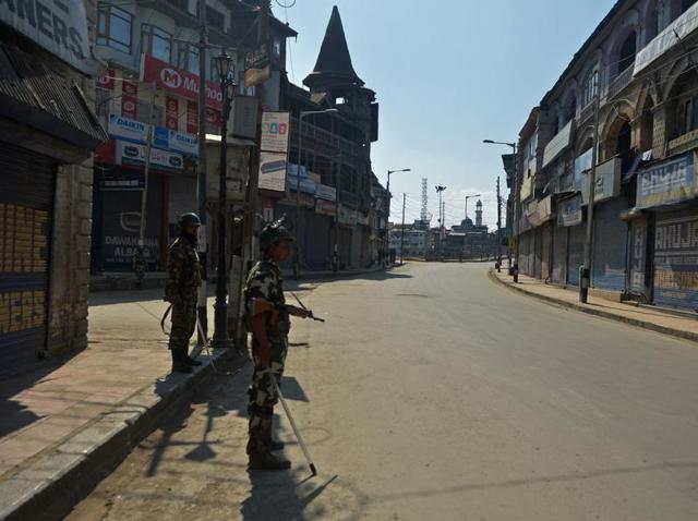A soldier stands guard during a curfew in the Lal Chowk area of central Srinagar.