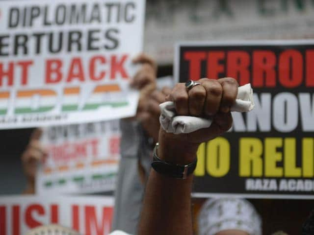 A man raises his fist in air while protesting in Mumbai on Tuesday following a militant attack at the Uri army base.