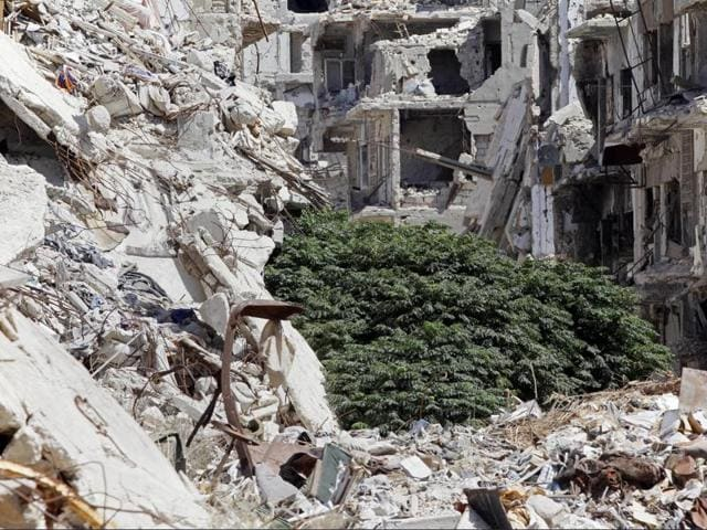 Damaged buildings and rubble line a street in the Old City, Homs, Syria. Britain said it had taken part in a US-led air strikes in Syria over the weekend that Russia says killed Syrian soldiers.