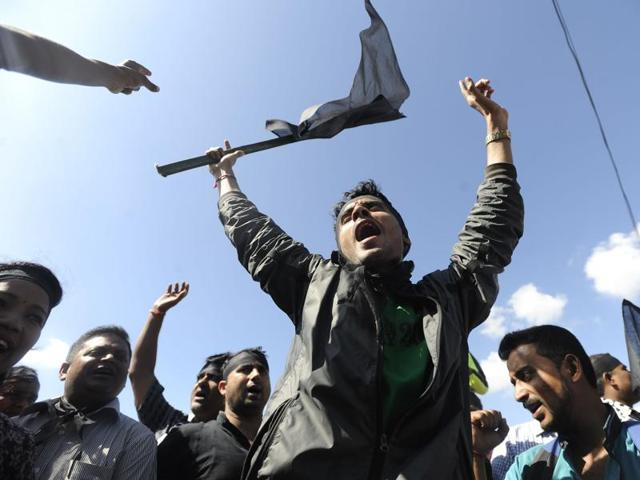 Nepalese activists from the Federal Alliance (members of the Madhesi and ethnic communities) chant anti-constitution slogans on the first anniversary of Nepal's new constitution in Kathmandu on Monday