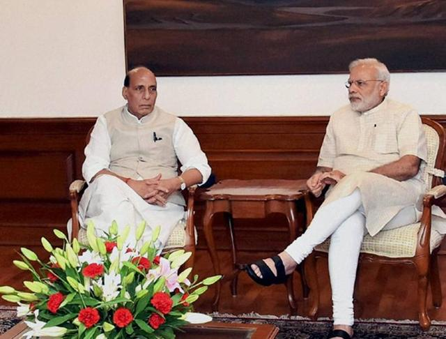 Prime Minister Narendra Modi with home minister Rajnath Singh at a meeting in the wake of the Uri attack, in New Delhi on Monday.