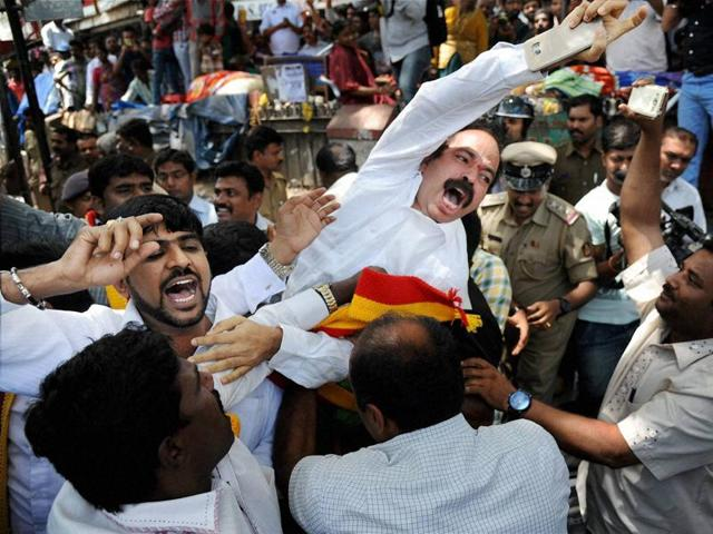 Police arrest Kannada activists trying to enter a railway station to stop trains during their protest over Cauvery water issue in Bengaluru on Thursday.(PTI Photo)