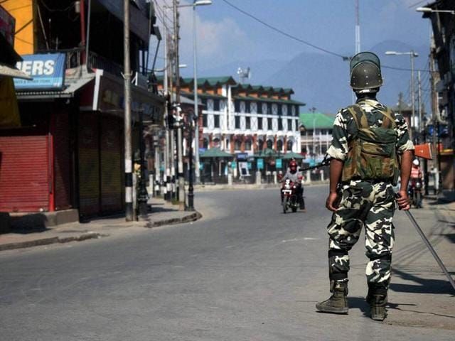 A security person stands guard at Lal Chowk after security arrangements were increased following the attack on Army camp in Uri, in Srinagar.