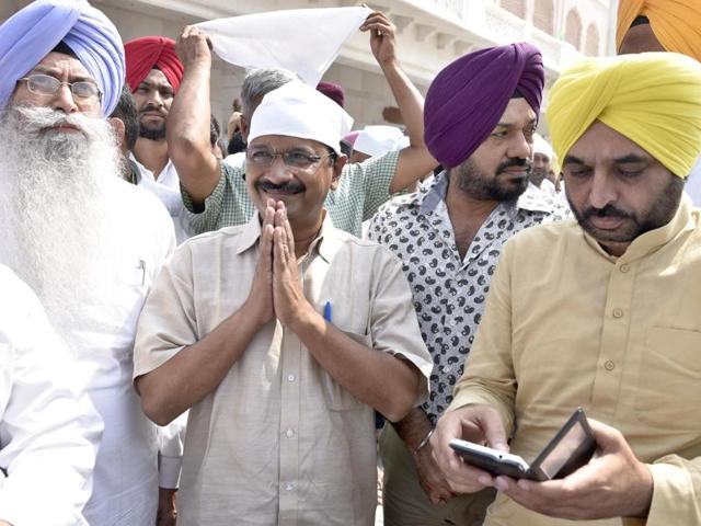 Delhi chief minister and AAP chief Arvind Kejriwal with party's Punjab convener Gurpreet Ghuggi and Bhagwant Mann at the Golden Temple in Amritsar.