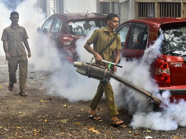Civic workers fumigate a the premises of a housing society on September 19.
