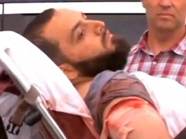 A still image captured from a video from WABC television shows a conscious man believed to be New York bombing suspect Ahmad Khan Rahami being loaded into an ambulance after a shoot-out with police in Linden, New Jersey.