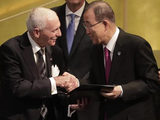 United Nations secretary-general Ban Ki-moon, right, shakes hands with William Lacy Swing, director general of the International Organisation for Migration, after signing documents during the opening of a summit to address large movements of refugees and migrants at UN headquarters on Monday.