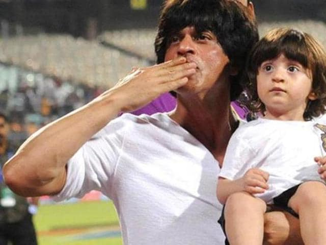 Shah Rukh with AbRam during one of the matches played by his IPL team KKR. (HT Photo)