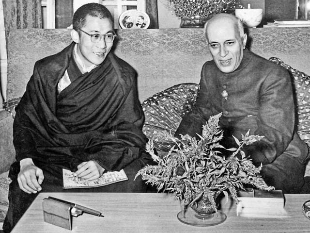 Tibetan spiritual leader The Dalai Lama at a meeting with the then Indian Prime Minister Jawaharlal Nehru in 1956.(Popperfoto/Getty Images)