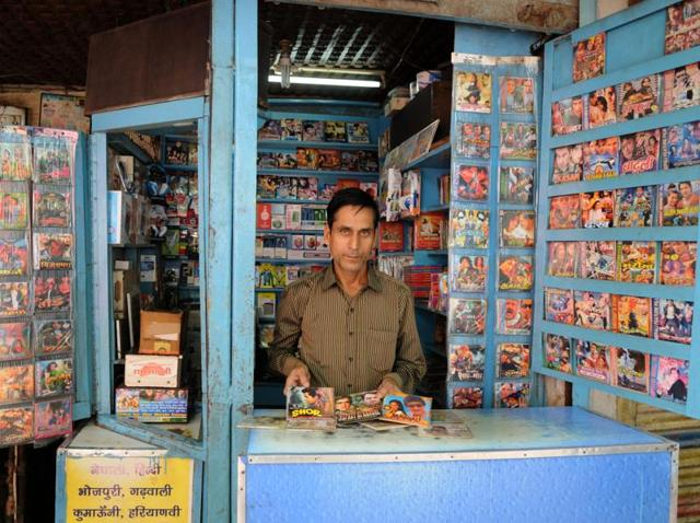 Invasion of smartphones, pen drives, and portable media players is something which is bowing down 48-year-old Rajender Gupta (above) who runs a 5x5 shop in a lane behind Gurgaon bus stand.