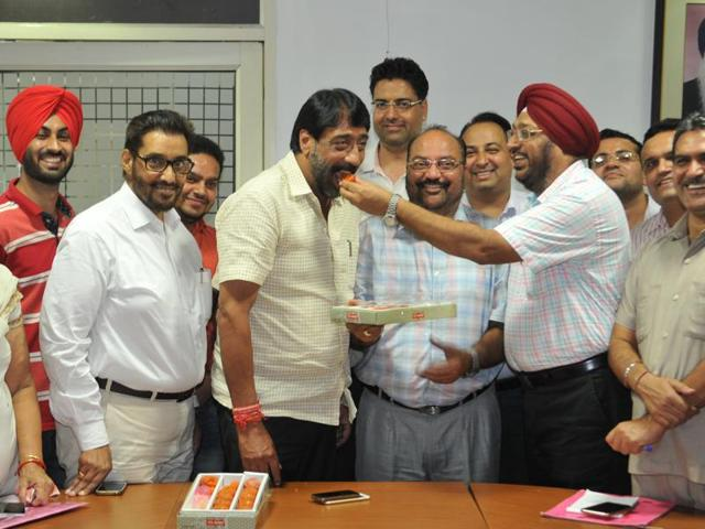 Officials offering sweets to mayor Sunil Jyoti in Jalandhar on Tuesday.