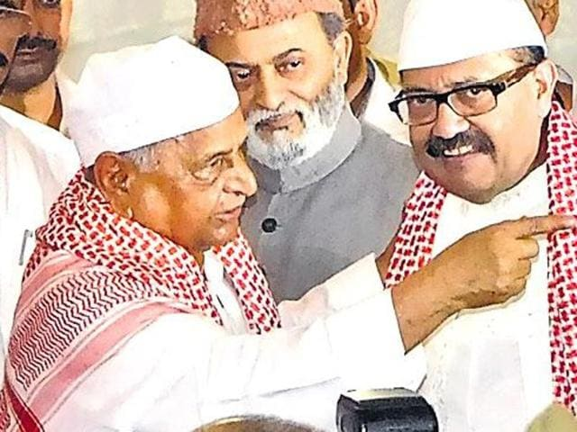 Samajwadi Party leader Amar Singh (L) with party president Mulayam Singh attend an Iftar party in this undated file photo.