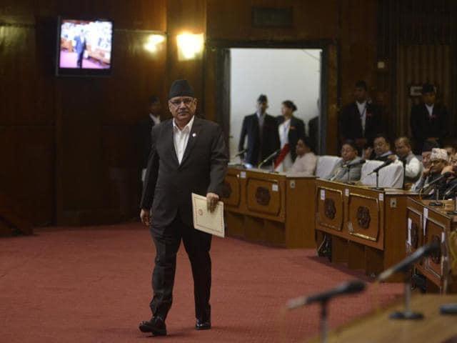 Nepalese Prime Minister Pushpa Kamal Dahal, also known as Prachanda, walks before addressing parliament in Kathmandu on September 8, 2016.