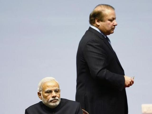 Pakistan Prime Minister Nawaz Sharif walks past PM Modi (foreground) during the SAARC summit in Kathmandu.(Reuters File Photo)