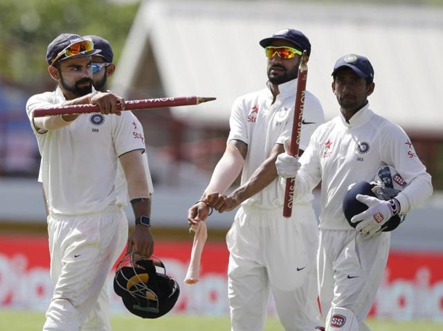 Anil Kumble and his team mates appeal for the dismissal of Adam Gilchrist, caught and bowled by Kumble, during a test match between Australia and India, in Melbourne. Twitter users voted to have Kumble in their dream Indian Test team for his spinning chops.