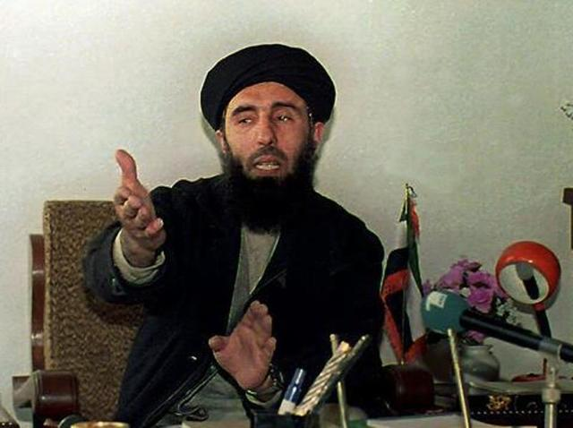 This file photo taken on January 12, 1994 shows Afghan warlord Gulbuddin Hekmatyar addressing a press conference at his headquarter in Chahar Saib, south of Kabul, on January 12, 1994