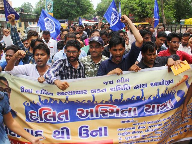 Dalits shout slogans during a protest march on  Aug 5, 2016 from Ahmedabad to Una town where four Dalits were flogged by alleged cow-vigilantes for skinning a dead cow .