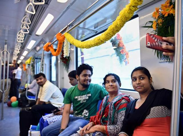 Passengers take a photo on board the metro train linking Little Mount and Chennai airport. The metro section was inaugurated by chief minister J Jayalalithaa on September 21, 2016.