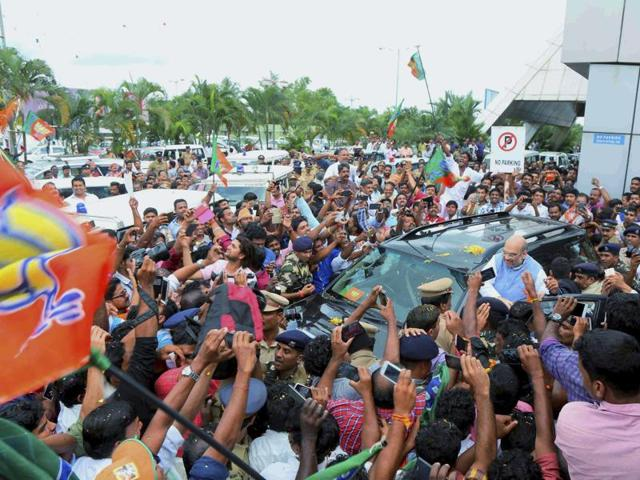 BJP president Amit Shah is welcomed by party workers on his arrival at the aiport in Kozhikode on Thursday.