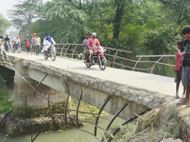 The dilapidated bridge from which the school van fell into a drain on Tuesday, claiming lives of seven children.