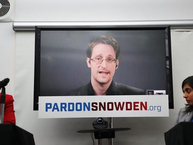 Edward Snowden speaks via video link at a news conference for the launch of a campaign calling for President Obama to pardon him on September 14, 2016.
