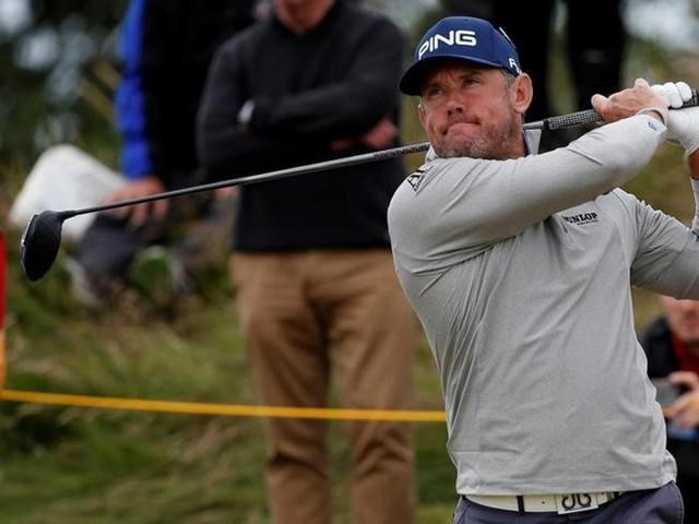 Lee Westwood (right) said Tiger Woods could adversely effect USA's chances in the Ryder Cup.