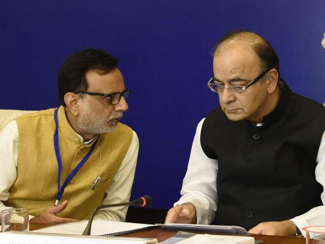 Finance minister Arun Jaitley with financial services secretary Hasmukh Adhia attend the first meeting of the Goods and Services Tax Council at Vigyan Bhawan in New Delhi on Thursday.