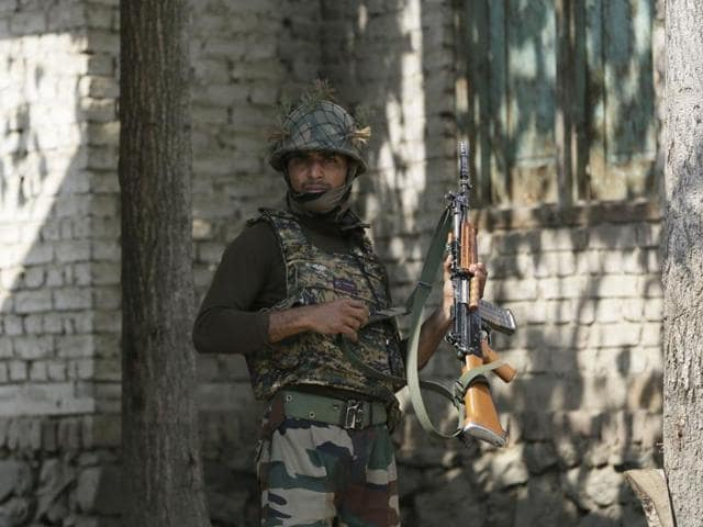 An Indian army soldier stands at his post in Braripora, near the de facto border dividing Kashmir between India and Pakistan.  Thursday's encounter comes three days after militants believed to be from Pakistan attacked an army camp in Uri.