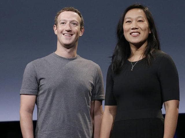 Facebook CEO Mark Zuckerberg and his wife, Priscilla Chan, rehearse for a speech in San Francisco. Zuckerberg and Chan have a new goal: to cure, manage or eradicate all disease by the end of this century.