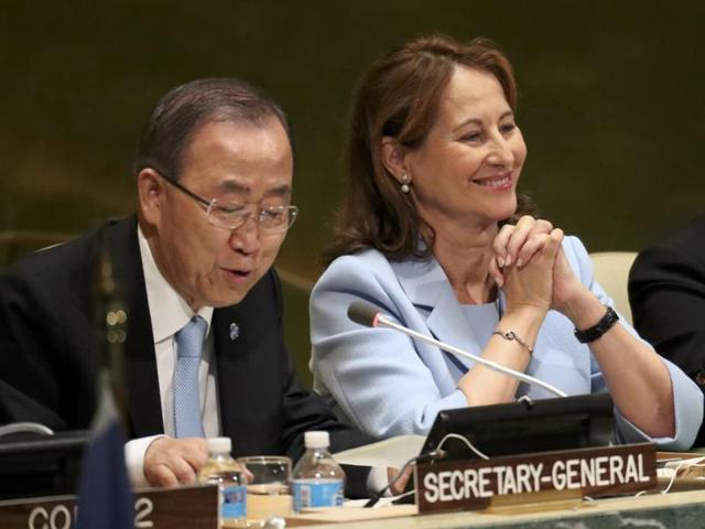 """French minister for environment Segolene Royal (C) looks on as UN secretary general Ban Ki-moon (L) concludes a """"high-level event on entry into force of the Paris agreement on climate change"""" meeting at United Nations headquarters in New York on Wednesday"""