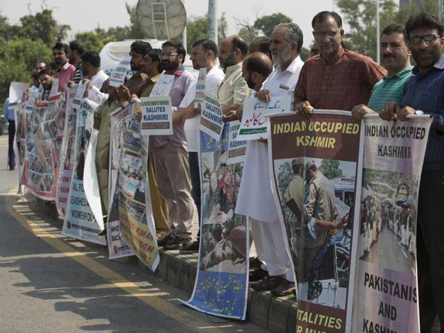 Supporters of Kashmiri party, All Parties Hurriyat Conference, gather for a protest in Islamabad.