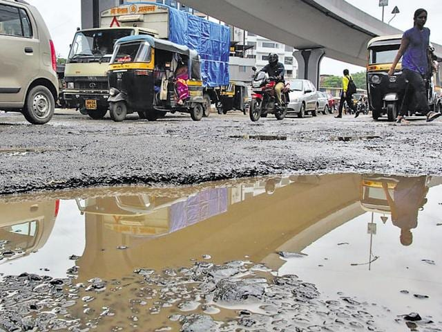 A pothole-infested  road in Vile Parle.
