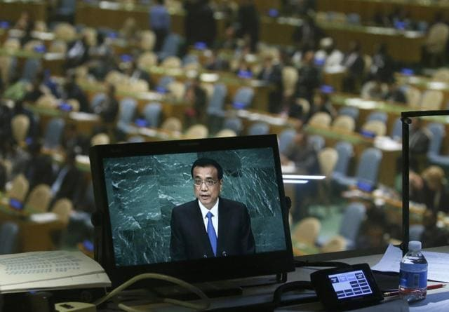 Chinese Premier Li Keqiang is seen on a monitor in a booth as he addresses the United Nations General Assembly in the Manhattan.