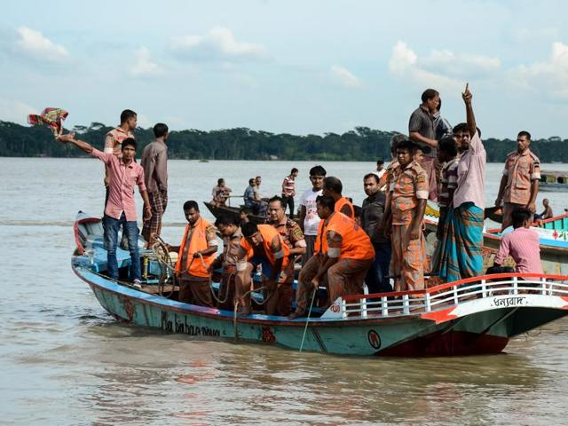 Rescue workers look for survivors after a ferry sank in Barisal, Bangladesh, on Wednesday.