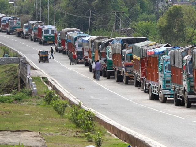 Stranded trucks wait for the Jammu-Srinagar highway to reopen on the outskirts of Jammu. Works on several road projects along the India-China border have been stalled due to several logistics, including the Kashmir violence.