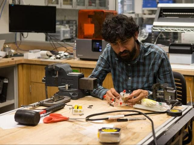 "Stanford University physical biologist Manu Prakash was named a MacArthur fellow for his work on ""frugal science,"" including an origami microscope."