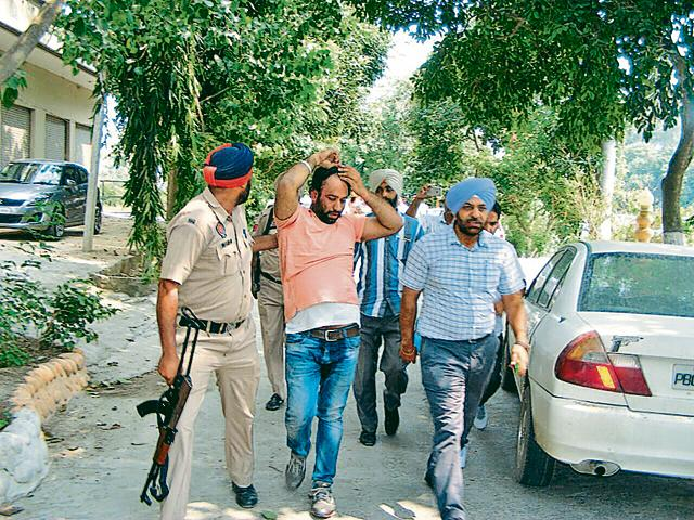 Police taking the accused into custody at Sultanpur Lodhi in Kapurthala district on Thursday.